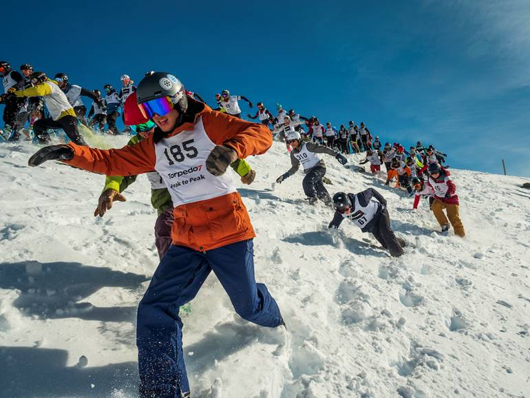 Peak to Peak competitors running from the startline on The Remarkables Ski Field.jpg
