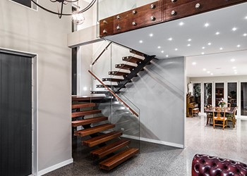 Luxury new home builders, floating stairs with a concrete floor